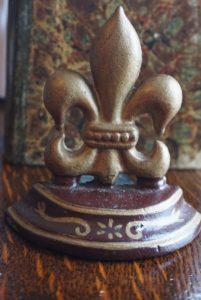 Antique victorian cast iron door stop fleur de lys