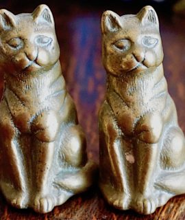 A pair of vintage brass cats