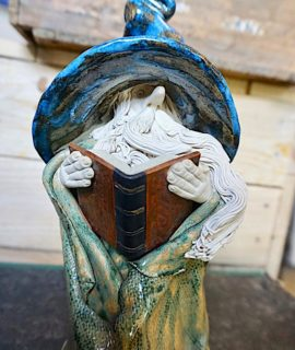 Large signed ceramic wizard with book