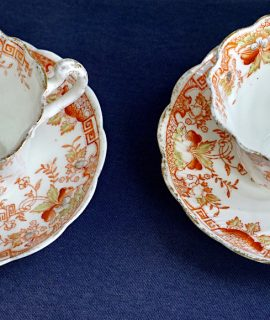 Set of two antique china cups and saucers